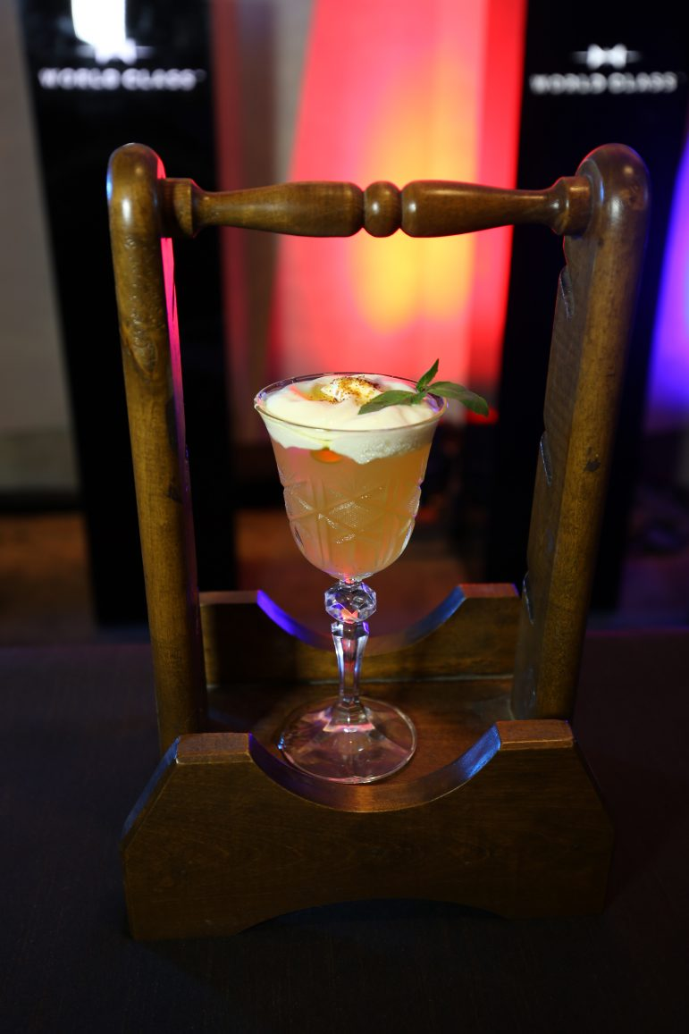 """For his cocktail called """"Papa John's,"""" Lloyd Misagal of ABV emulated the flavors of pizza with pepperoni-infused Lagavulin 16, homemade tomato consommé, and mozzarella foam."""